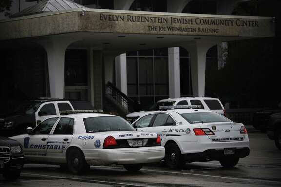Police officers search the Evelyn Rubenstein Jewish Community Center in Houston after a fake bomb threat was called in Monday.