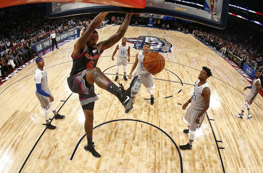 The entire East team watches while DeAndre Jordan goes in for an uncontested dunk, a common site at the All-Star Game. Photo: Larry W. Smith, Associated Press