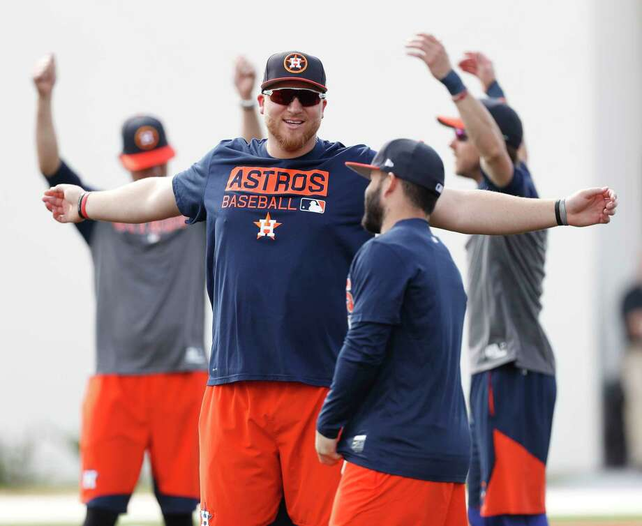 """At 6-4 and 275 pounds, A.J. Reed, left, dwarfs Jose Altuve and maintains he """"didn't really lose any weight, but I feel like I just kind of transferred it."""" Photo: Karen Warren, Staff Photographer / 2017 Houston Chronicle"""