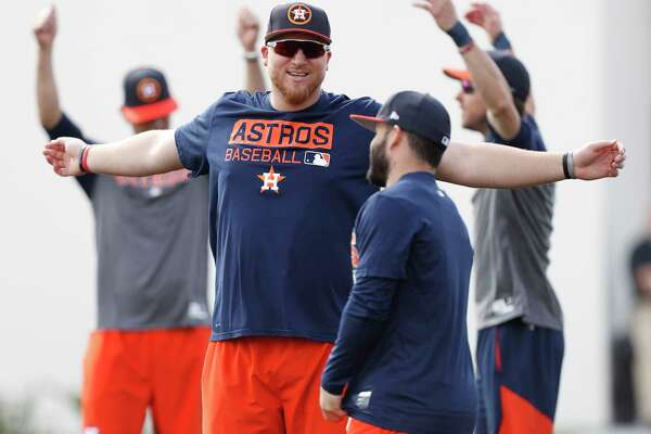 "At 6-4 and 275 pounds, A.J. Reed, left, dwarfs Jose Altuve and maintains he ""didn't really lose any weight, but I feel like I just kind of transferred it."""