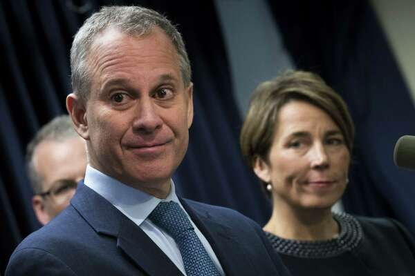 NEW YORK, NY - JULY 19: ( L to R) New York Attorney General Eric Schneiderman and Massachusetts Attorney General Maura Healey listen to a question from a reporter during a press conference at the office of the New York Attorney General, July 19, 2016 in New York City. They announced lawsuits against Volkswagen AG and its affiliates Audi AG and Porsche AG for their sale of diesel vehicles that were outfitted with illegal 'defeat devices' that concealed illegal amounts of emissions and the subsequent cover-up. (Photo by Drew Angerer/Getty Images) ORG XMIT: 655969063