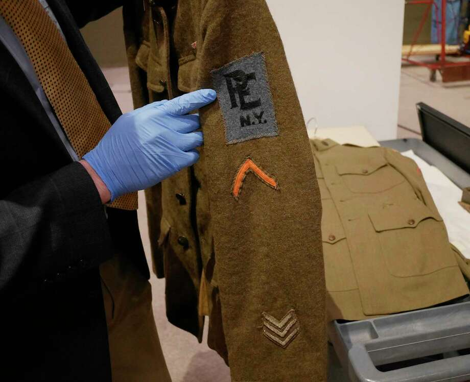 Aaron Noble, a senior historian at the New York State Museum, holds a World War I Medical Corps soldier's tunic on Thursday, Feb. 16, 2017 in Albany, N.Y.  This item will be part of an exhibit on World War I at the State Museum.    (Paul Buckowski / Times Union) Photo: PAUL BUCKOWSKI / 20039684A