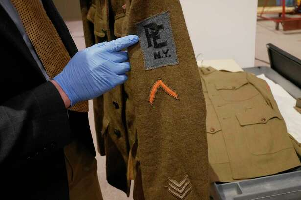 Aaron Noble, a senior historian at the New York State Museum, holds a World War I Medical Corps soldier's tunic on Thursday, Feb. 16, 2017 in Albany, N.Y.  This item will be part of an exhibit on World War I at the State Museum.    (Paul Buckowski / Times Union)