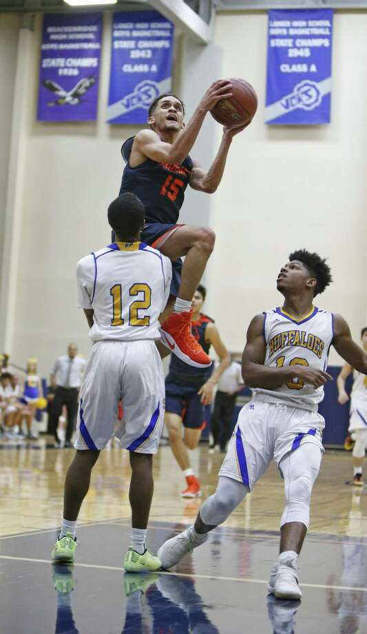 Brandeis' Kobe Magee looks toward the rim as Clemens' Yonas Gordon tries to stand in his way at Alamo Convocation Center. Photo: Ron Cortes / For The Express-News