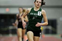 New Milford's Mia Nahom opens up a large lead on the way to an easy win in the 1600 meters at the CIAC State Championship Indoor Track & Field Meet at the Floyd Little Athletic Center in New Haven, Conn. on Monday, February 20, 2016.