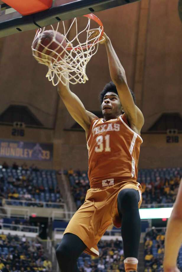 Texas forward Jarrett Allen (31) dunks the ball during the first half of an NCAA college basketball game against West Virginia, Monday, Feb. 20, 2017, in Morgantown, W.Va. (AP Photo/Raymond Thompson) ORG XMIT: WVRT101 Photo: Ray Thompson / FR171247 AP