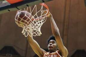 Texas forward Jarrett Allen (31) dunks the ball during the first half of an NCAA college basketball game against West Virginia, Monday, Feb. 20, 2017, in Morgantown, W.Va. (AP Photo/Raymond Thompson) ORG XMIT: WVRT101