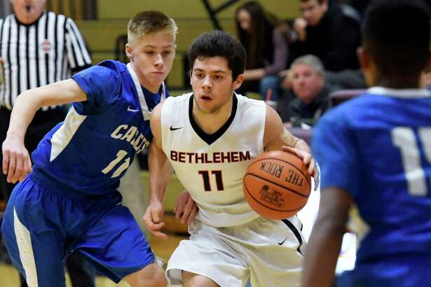 Bethlehem's Matthew Riker, center, controls the ball as La Salle's Connor Cepiel defends during the championship basketball game of the CBA Holiday Tournament on Friday, Dec. 30, 2016, at Christian Brothers Academy in Colonie, N.Y. (Cindy Schultz / Times Union)