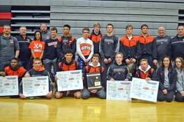 The Edwardsville wrestling team poses with the Class 3A Granite City Regional championship plaque after winning the regional on Feb. 4. The Tigers will face Lockport in the team sectional tonight.