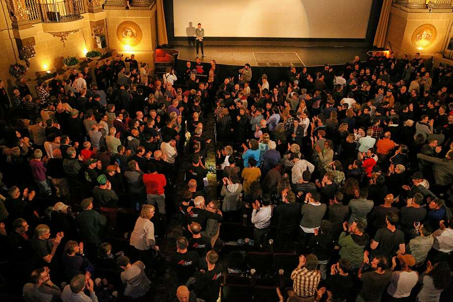 """Audience members cheer the San Francisco Gay Men's Chorus inside the Castro Theatre following their performance during the intermission of """"When We Rise"""" on Monday, Feb. 20, 2017, in San Francisco, Calif. The ABC mini-series """"When We Rise"""" was written and created by Dustin Lance Black, who is seen on stage. Photo: Santiago Mejia, The Chronicle"""