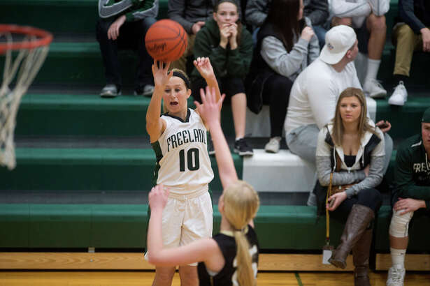 BRITTNEY LOHMILLER   blohmiller@mdn.net Freeland's Carlee Hutchison shoots a 3-pointer in last Friday's game against Bullock Creek. Despite not having a superstar or anyone who averages much more than 10 points per game, the Falcons are on the verge of what would likely be their first 20-0 regular season.