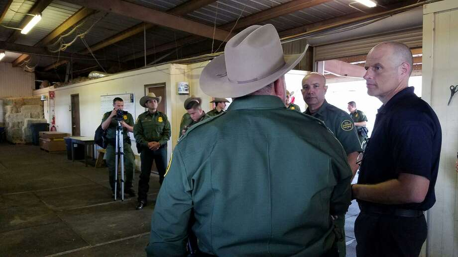 Gilbert de los Santos, special operations supervisor with the Horse Patrol unit, gives a tour of the horse stables to Laredo Sector Chief Patrol Agent Mario Martinez and U.S. Border Patrol Chief Ronald Vitiello on Monday afternoon. Photo: César G. Rodriguez /Laredo Morning Times