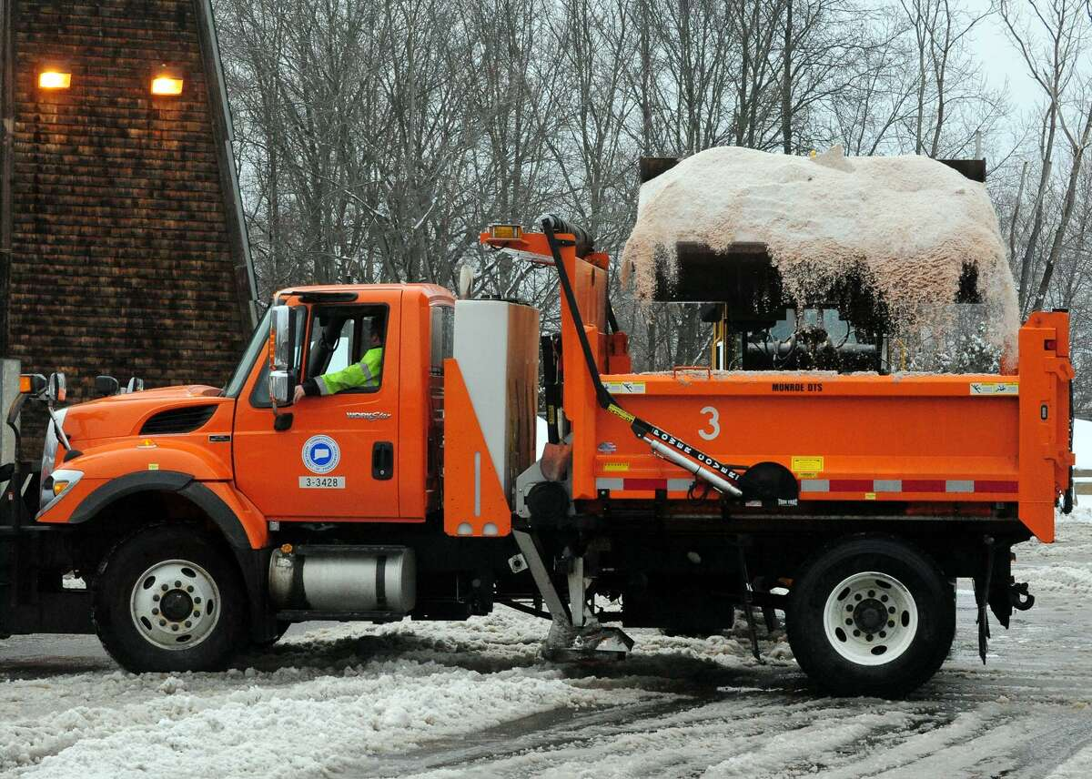 Plow trucks at the Connecticut D.O.T. facility in Trumbull, Conn. get loaded up with salt for the roads after a snow storm on Wednesday February 5, 2014.