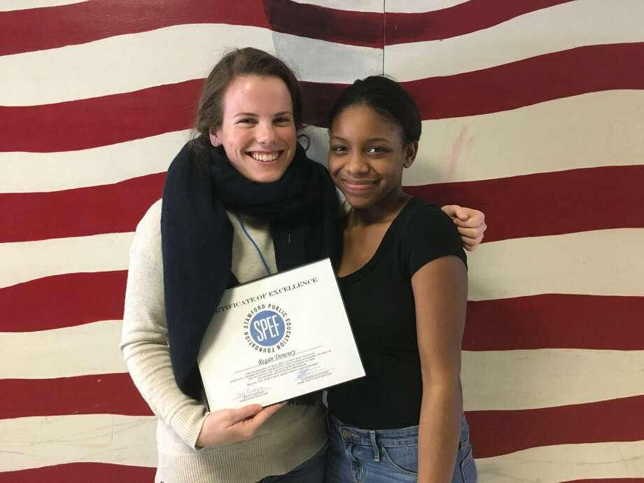 Regan Downey smiles with her mentee after receiving her Community Volunteer Award last week from the Stamford Public Education Foundation. Photo: Contributed / Stamford Public Education Foundation