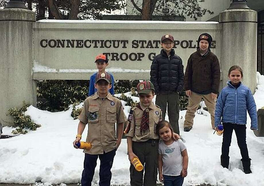 Members of the Webelos Scouts from Pack 20 Cos Cob recently got an inside look on what it takes to be a Connecticut state trooper by visiting the Troop G barracks in Bridgeport. Photo: /