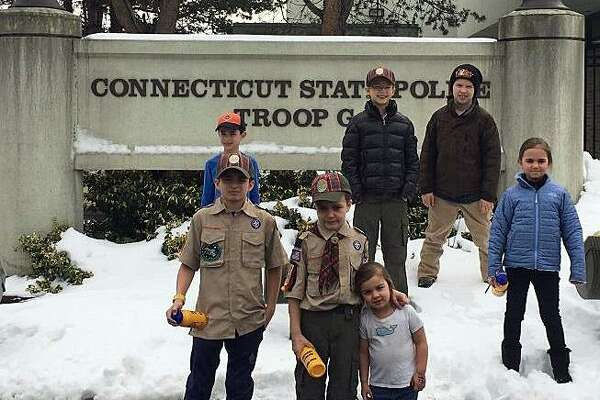 Members of the Webelos Scouts from Pack 20 Cos Cob recently got an inside look on what it takes to be a Connecticut state trooper by visiting the Troop G barracks in Bridgeport.