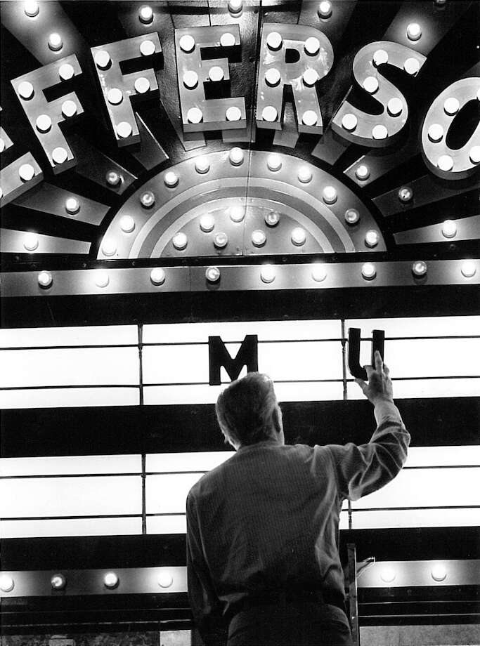 Walter Doiron add letters to the marque at the Jefferson Theatre on January 30, 1987. The marque had been newly renovated at the time. Enterprise archive photo