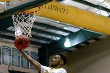 La Marque's Desmond Murray shoots a layup against Kirbyville during the first quarter of a class 3A bi-district playoff game at East Chambers High School on Monday evening.   Photo taken Monday 2/20/17 Ryan Pelham/The Enterprise