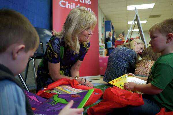 Dr. Jill Biden speaks with students Gus Mathis, 4, right, and Cole Swindle, 4, during Biden's visit with Save the Children at Linden Elementary School in Linden, Tenn., on Wednesday, Feb. 15, 2017.