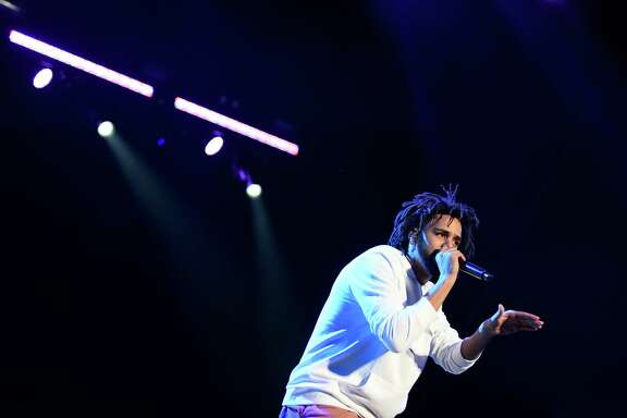 J. Cole performs during the final performance of the first day of the Outside Lands music festival on Friday, August 5, 2016 in San Francisco, California.