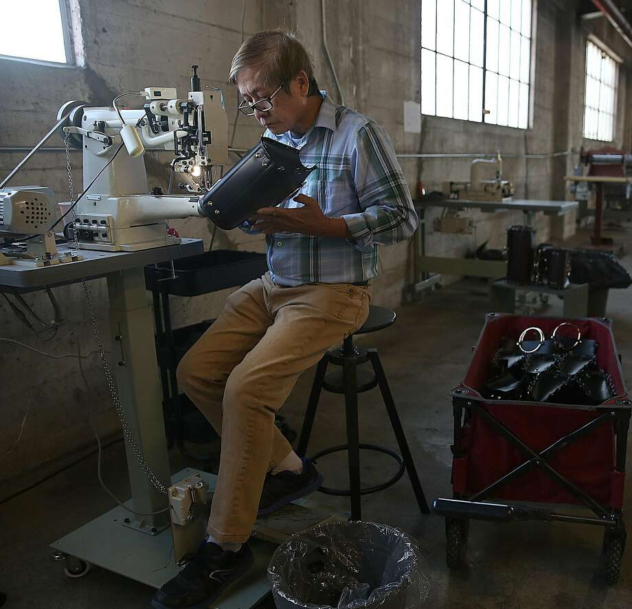 At Future Glory in Dogpatch, senior sewer Mo Chan works on a bag. Photo: Liz Hafalia, The Chronicle