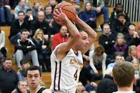 Colonie's #4 Josh Paszkowski goes airborne to move the ball during Friday's game against Bethlehem Feb. 10, 2017 in Colonie, NY.  (John Carl D'Annibale / Times Union)