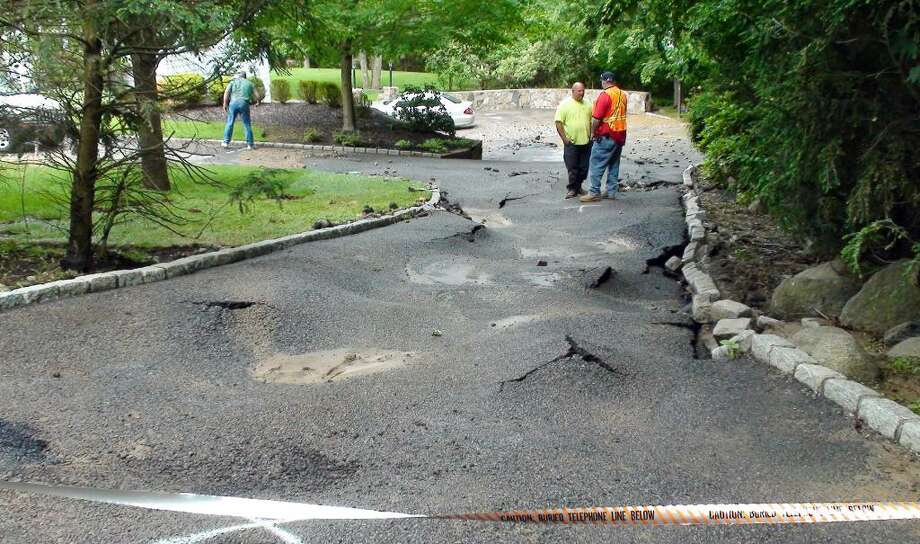 Damage in the driveway at 38 Dairy Road in Greenwich, Saturday, May 29, 2010, from a water main break, which happened around 8 p.m. last night according to Charles Cortese who lives at 42 Dairy Road.  Cortese says he sustained property damage when the water flowed onto his property.  Cortese says the water main was shut off at 10 p.m. Friday. Photo: Contributed Photo, Charles Cortese/Contributed Photo / Greenwich Time Contributed