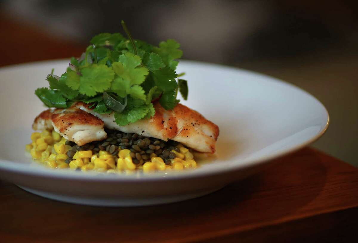 The grouper with curry corn, lentils and cilantro salad at The Pearl Restaurant & Bar inside the Sam Houston Hotel.