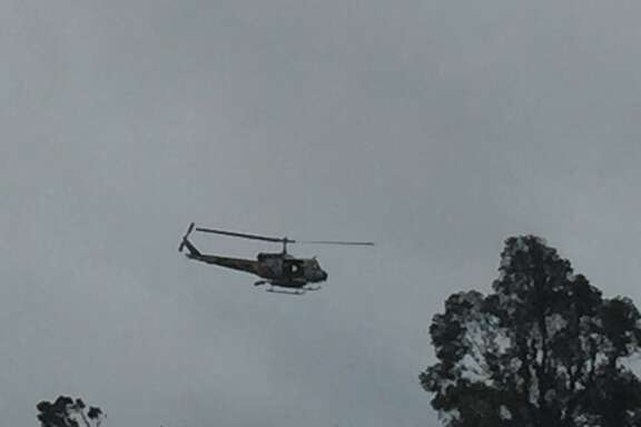 Cal fire helicopter hovering over Los Lagos golf course in San Jose after flooding left homeless people stranded.
