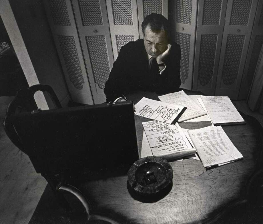 Alone in his hotel room, the presidential nominee Richard Nixon writes his acceptance speech, Republican National Convention, Miami Beach, 1968.David Douglas Duncan (American, b. 1916).Gelatin silver print, 8 13/16 x 13 7/16 inches. Photo: Courtesy Harry Ransom Center / Courtesy Harry Ransom Center