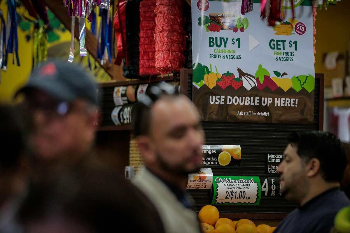 """A sign for """"Double Up Food Bucks"""" is seen at Arteagas Food Center in San Jose, California, on Sunday, Feb. 19, 2017."""
