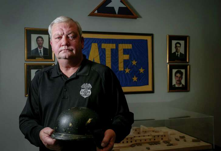 ATF Assistant Special Agent in Charge Gary Orchowski holds a helmet he used during the raid on the Branch Davidian compound is seen Monday, Jan. 9, 2017, in Houston. The helmet was hit by two rounds during the firefight. ( Jon Shapley / Houston Chronicle )