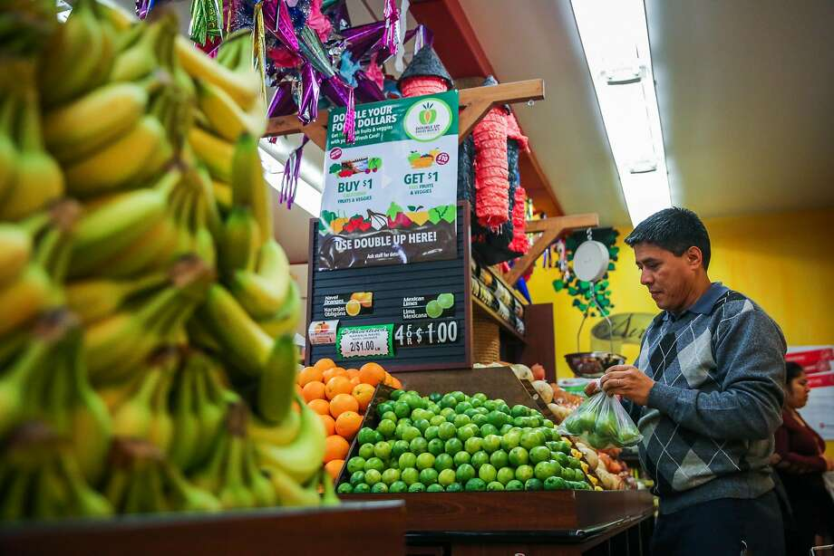Ismael Alcala shops for produce at Arteaga's Food Center in San Jose, which is part of the Double Up Food Bucks program that gives CalFresh recipients more money to buy fresh produce. Photo: Gabrielle Lurie, The Chronicle