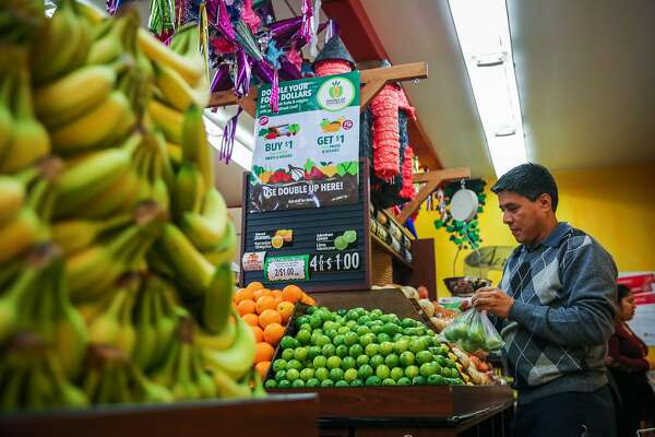 Ismael Alcala shops for produce at Arteagas Food Center in San Jose, California, on Sunday, Feb. 19, 2017.