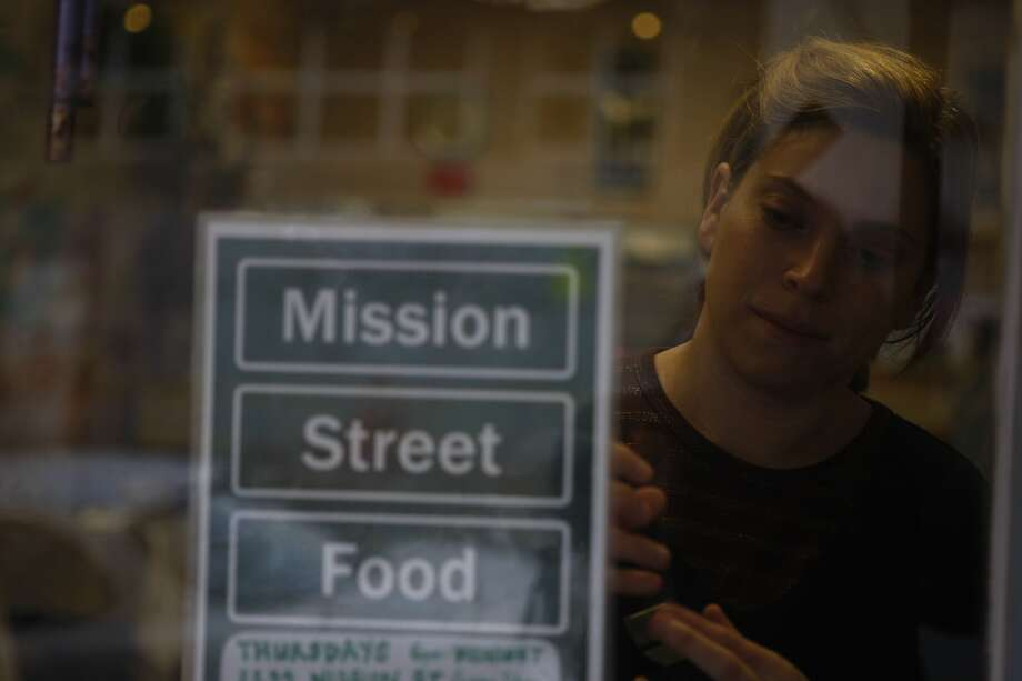 Co-founder Karen Leibowitz puts up the name change for Mission Street Food in San Francisco. Photo: Eric Luse, The Chronicle