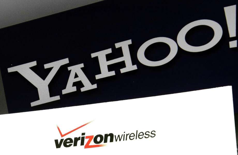 Yahoo is taking a $350 million hit on its previously announced $4.8 billion sale to Verizon in a concession for security lapses that exposed personal information stored in more than 1 billion Yahoo user accounts. Photo: Associated Press /File Photo / AP