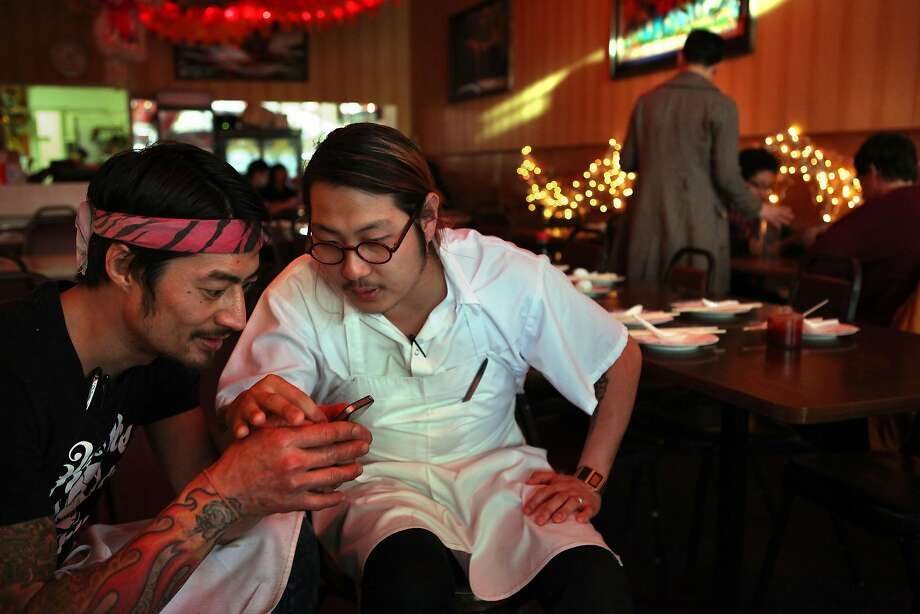 Sous chef Jesse Koide (left) and Danny Bowien (right) have a meeting  at Mission Chinese Food, 2011.  Photo: Liz Hafalia, The Chronicle
