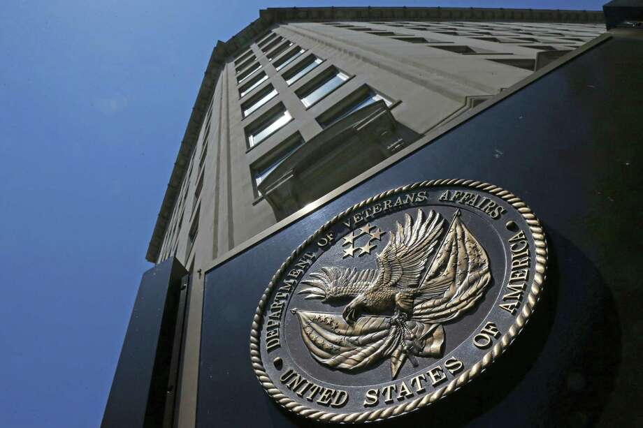 FILE - In this June 21, 2013 file photo, the Veterans Affairs Department in Washington. Federal authorities are stepping up investigations at Department of Veterans Affairs medical centers due to a sharp increase in opioid theft, missing prescriptions or unauthorized drug use by VA employees since 2009, according to government data obtained by The Associated Press. (AP Photo/Charles Dharapak, File) Photo: Charles Dharapak, STF / Associated Press / AP2013