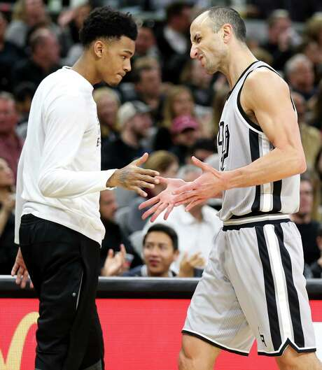 San Antonio Spurs' Dejounte Murray celebrates with Manu Ginobili after Ginobili made a 3-pointer during first half action against the Dallas Mavericks Sunday Jan. 29, 2017 at the AT&T Center. Photo: Edward A. Ornelas, Staff / San Antonio Express-News / © 2017 San Antonio Express-News