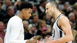 San Antonio Spurs' Dejounte Murray celebrates with Manu Ginobili after Ginobili made a 3-pointer during first half action against the Dallas Mavericks Sunday Jan. 29, 2017 at the AT&T Center.