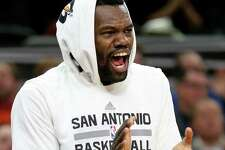 San Antonio Spurs' Dewayne Dedmon celebrates after a basket by LaMarcus Aldridge during first half action against the Dallas Mavericks Sunday Jan. 29, 2017 at the AT&T Center.