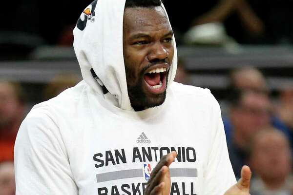 San Antonio Spurs' Dewayne Dedmon celebrates after a basket by LaMarcus Aldridge during first half action against the Dallas Mavericks Sunday Jan. 29, 2017 at the AT&T Center.