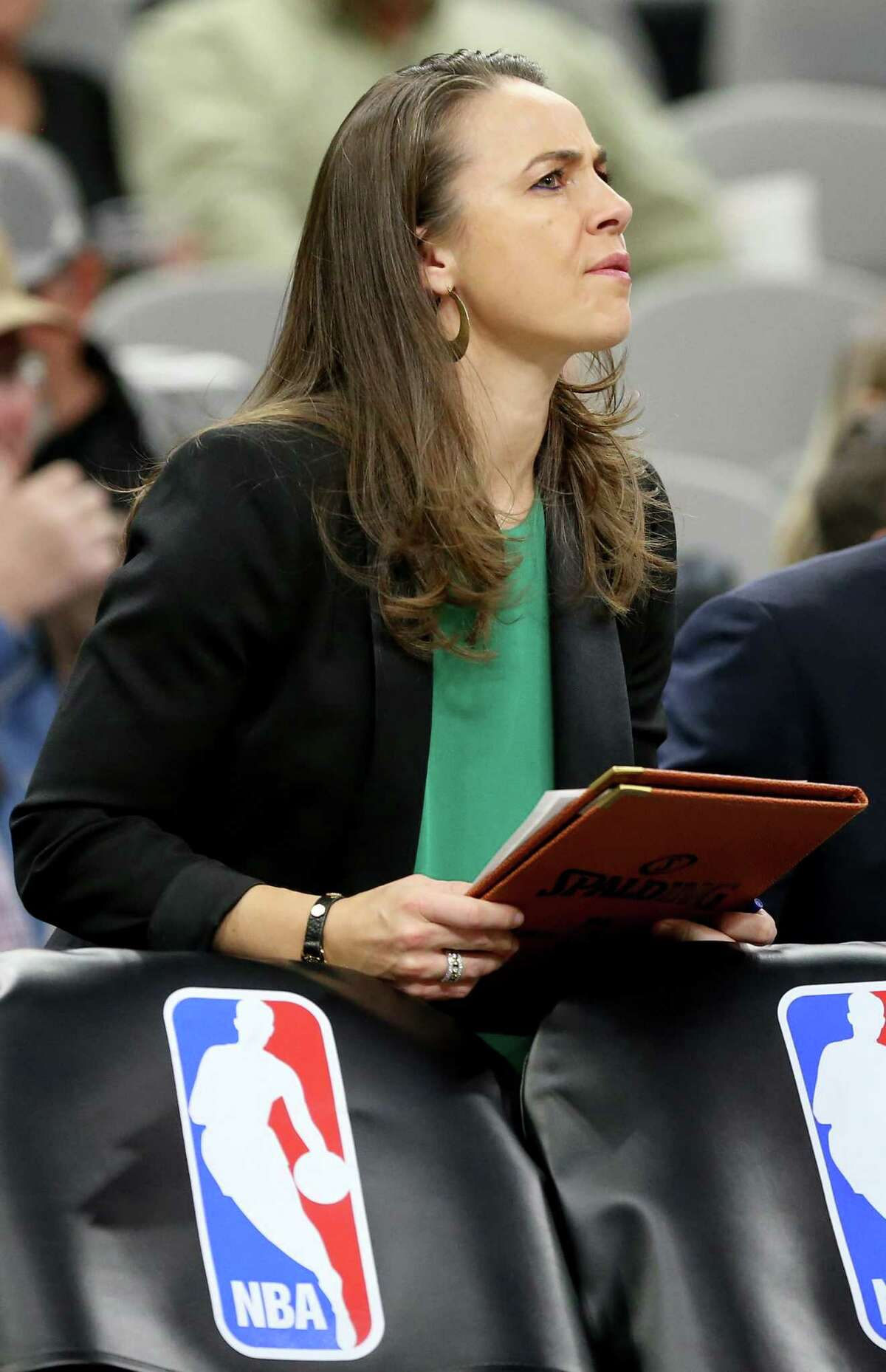 San Antonio Spurs assistant coach Becky Hammon pauses during a first half timeout against the Dallas Mavericks Sunday Jan. 29, 2017 at the AT&T Center.