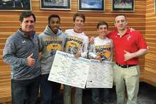Marking a first for GFA, two of its wrestlers captured two New England titles in a single season. In last weekend's New England Independent School Wrestling Association Championship, senior Hans Forland (center) captured the title in the 126 weight class, while junior Sam Stuart (second from right) captured the 106 weight class title. Junior Nick Attai also qualified for the tournament. They were joined by coaches Pat Lennon (far left) and Jack Conroy (far right). Conroy was the last Dragon to win this tournament, back in 2005.