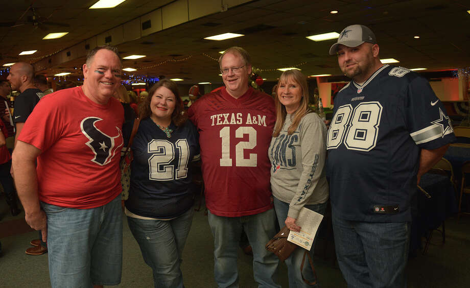 Bruce Hillegeist, from left, Paige Cassel-Williams, Jason Williams, Elaine Schwer, and Mark Lopas team-up for a photo during the Tomball Chamber Chairman's Ball Tailgate Party at Tomball VFW Post 2427 on Feb. 18, 2017. (Photo by Jerry Baker/Freelance) Photo: Jerry Baker, Freelance / Freelance