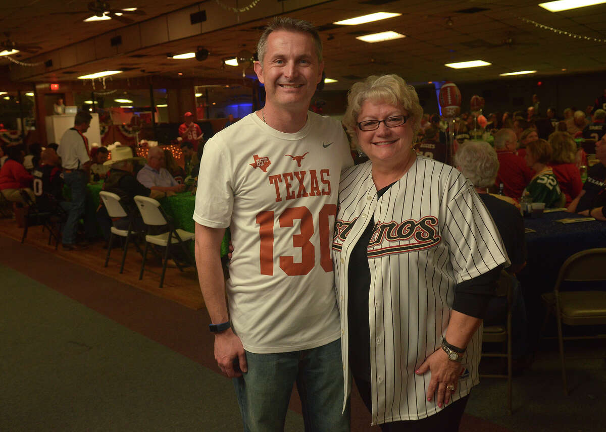 District 130 Texas State Representative Tom Oliverson, left, and Lori Klein Quinn, Mayor Pro-Tem of the Tomball City Council, team-up for a photo during the Tomball Chamber Chairman's Ball Tailgate Party at Tomball VFW Post 2427 on Feb. 18, 2017. (Photo by Jerry Baker/Freelance)