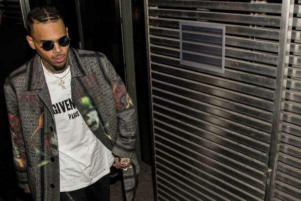 American singer Chris Brown arrives at the Givenchy Fall-winter 2016-2017 ready to wear fashion collection presentation on Sunday, March 6, 2016 in Paris.