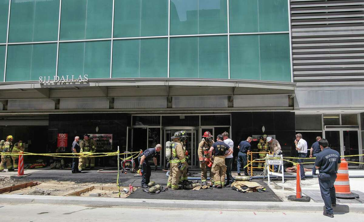 HFD firefighters check on a fire that was dispatched to a report of smoke in a high-rise building at 811 Dallas Monday, May 23, 2016, in Houston. A permit was filed with the city at the end of January 2017 for a partial demolition at the building. Click through the slideshow to see the tallest buildings in Houston.