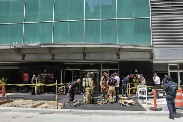 HFD firefighters  check on a fire that was dispatched to a report of smoke in a high-rise building at 811 Dallas Monday, May 23, 2016, in Houston.  The fire was upgraded to a 2-alarm at 1:57 p.m. Approximately 30 HFD units are on scene.
