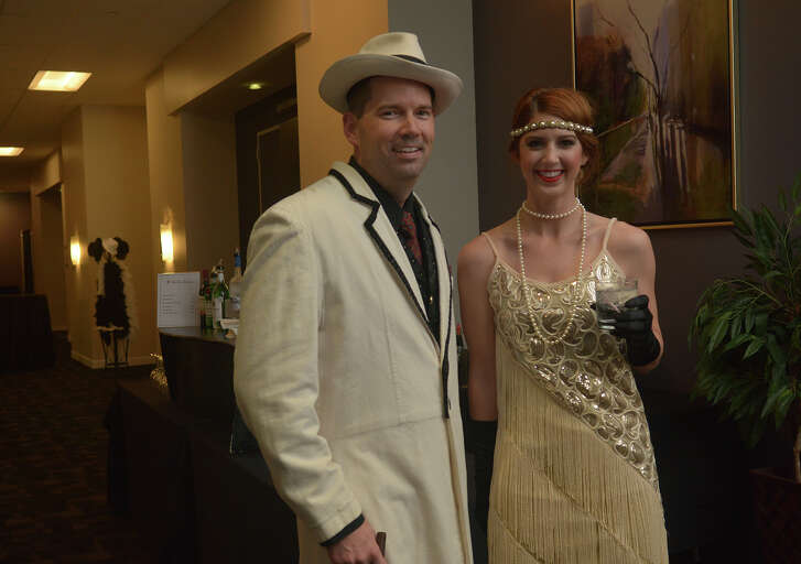 """Jason Culpepper, left, and Sara Theut show off their '20s flare during the Cy-Fair Houston Chamber of Commerce """"A Night of Celebration"""" gala at the Norris Conference Center in Houston on Feb. 17, 2017. (Photo by Jerry Baker/Freelance)"""